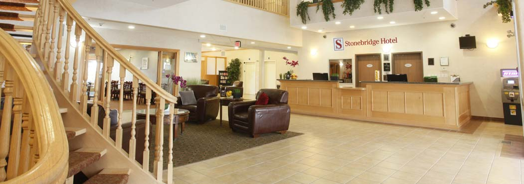 Stonebridge front lobby reception area with wooden staircase in Dawson Creek