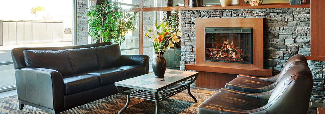 Stonebridge in Fort St. John front lobby seating area has an electric fire place