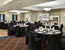 function room & a projection screen at Stonebridge Hotel in Grand Prairie