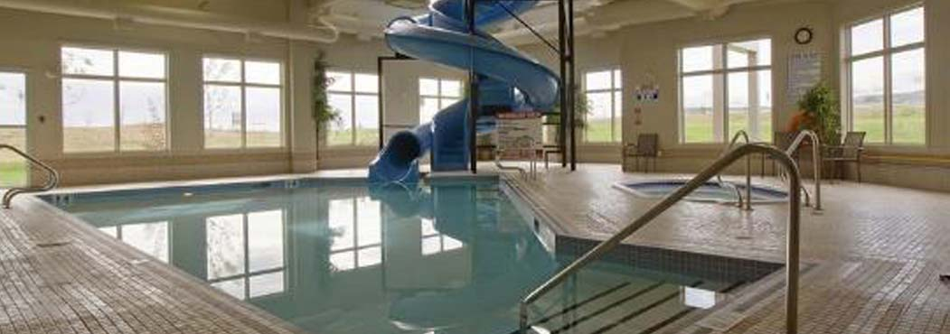 Dawson's Creek indoor heated pool with a waterslide at Stonebridge
