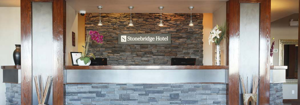 spacious hallways with wooden frame beams at Stonebridge Hotel in Fort St. John