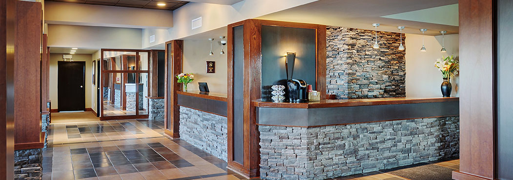 Stonebridge Hotel in Fort St. John reception desk with  stone color pillars
