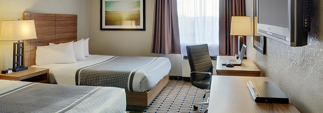 Stonebridge Hotel By Pomeroy twin double beds with wooden head boards