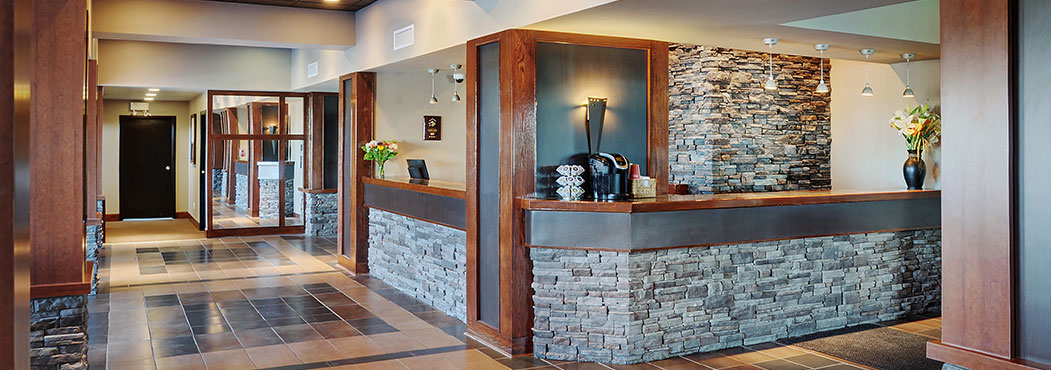 front reception design with blue brick color in Fort St. John at Stonebridge
